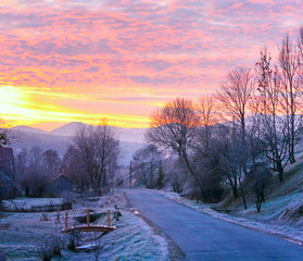 Sunrise and mountain village road