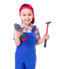 Little handyman with drill and hammer