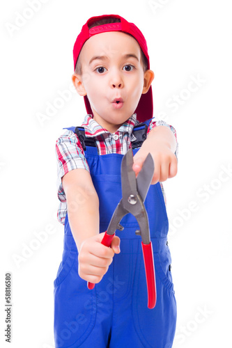 Boy showing shear cutting scissors hazard