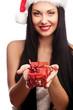Christmas santa woman holding gift.