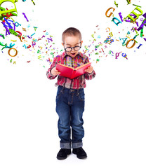 Little boy wondering of flying letters