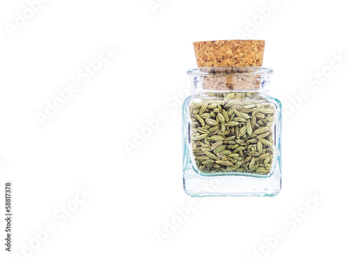 Sweet cumin spices in a corked bottle