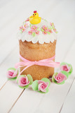 Decorated Easter cake, white wooden background, vertical shot