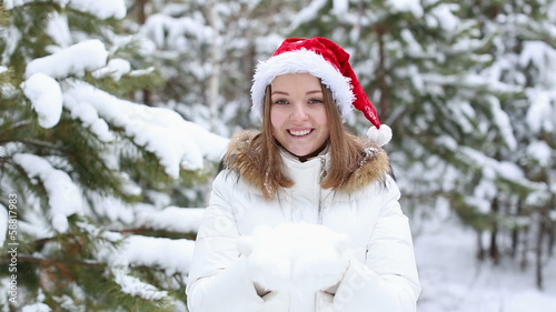 Happy Friendly Woman Blowing Snowflakes
