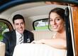 Bride and groom inside a beautiful classic car