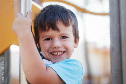 Happy young boy outdoor portrait