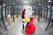Santa Claus preparing for Christmas in storehouse