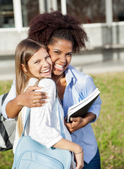 Loving Woman Embracing Friend On College Campus
