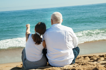 mature couple against sea
