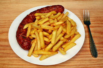 Fried fries with roasted sausage