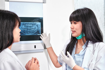 Examining teeth X Ray