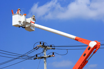Electrician lineman on  hydraulic platform .