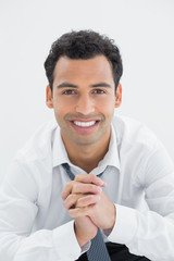 Close-up portrait of a happy young businessman