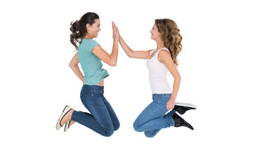 Young female friends playing clapping game
