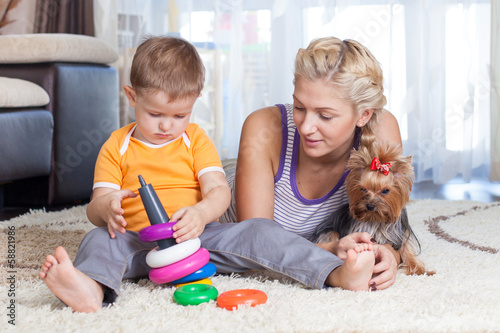 cute mother and kid boy play together indoor