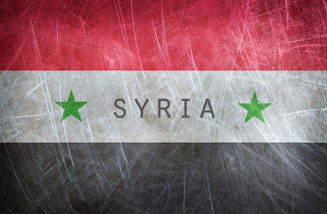 The flag of Syria. Grunge postcard