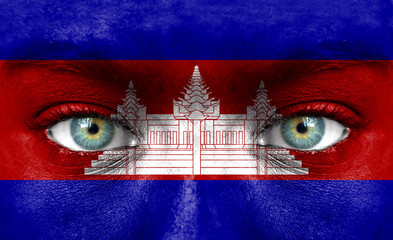 Human face painted with flag of Cambodia