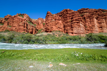 Rapid river and strange red rock formations
