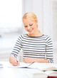 smiling woman studying in college