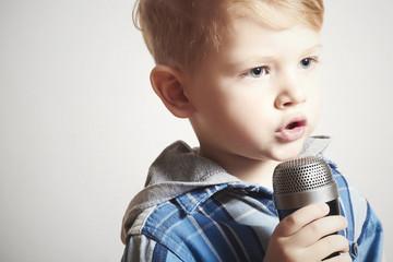 little boy singing in microphone.child in karaoke.music