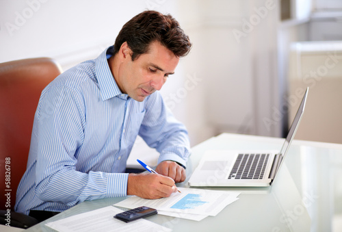 Attractive boss working on his documents