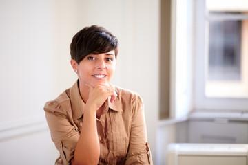 Latin entrepreneur young woman smiling at you