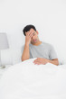 Man suffering from headache in bed