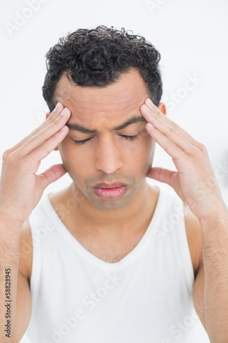 Close-up of a young man suffering from headache