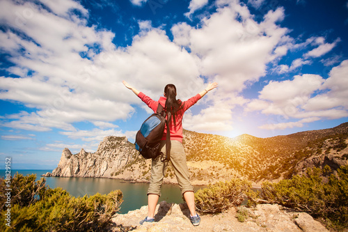woman tourist is enjoying landscape