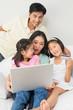 Family of four doing online shopping