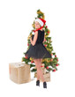 Beautiful blond smiling woman and the Christmas tree