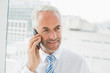 Close-up of a mature businessman using mobile phone