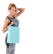 dreaming lovely woman with shopping bag