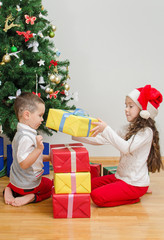 Brother and sister packing christmas gifts