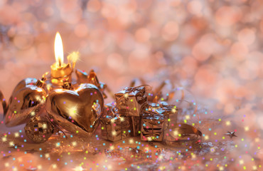 Christmas background with candle, hearts and gifts