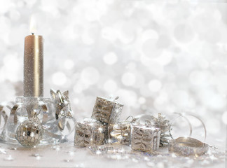 Christmas background with candles, ribbon and gifts