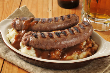 Bangers and mash on a wooden table