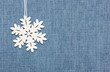 winter background: snowflake  on  jeans  fabric