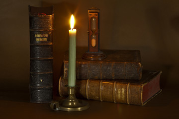 Old books and candle
