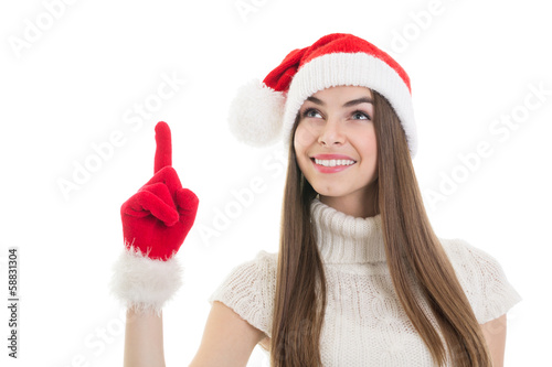 Excited teenage Santa girl pointing and looking up
