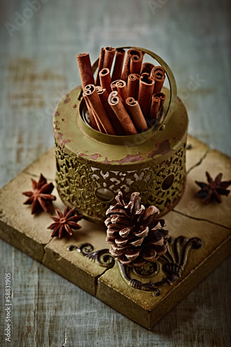 Cinnamon sticks in a rustic container