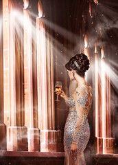 Woman in Evening Dress with Glass of Champagne in Sunshine