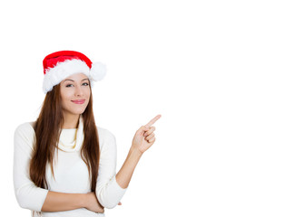 Happy christmas woman pointing at copy space