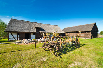 Old rural barn in Poland and threshing-machine- XIXth century
