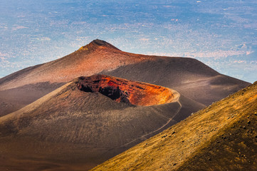 Colorful crater of Etna volcano with Catania in background, Sici
