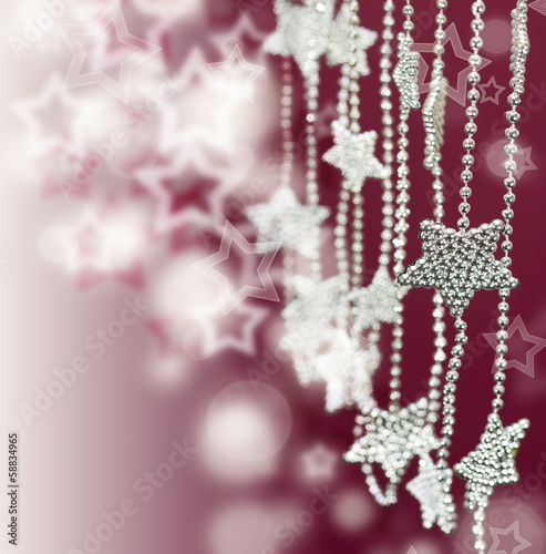 Silver Stars garland on pink blur background