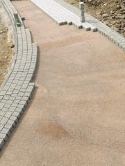 Unfinished pavement path