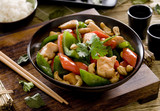Bowl of cashew chicken with vegetable stir fry.
