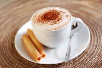 Hot creamy cappuccino drink.