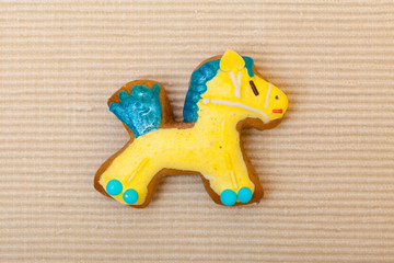Christmas gingerbread cake pony icing decoration on brown